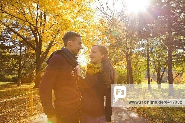 Young romantic couple in autumn park  Vienna  Austria