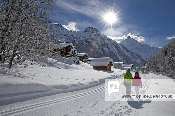 Switzerland  Europe  village  couple  couples  woman  man  two  snow  footpath  trail  hiking path  walking  hiking  winter  winter sports  canton  Valais  Zinal  Val d'Anniviers