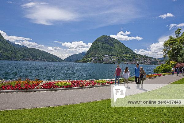 Switzerland  Europe  group  woman  man  couple  couples  lake  canton  TI  Ticino  Southern Switzerland  park  walking  Lugano  lake Lugano  San Salvatore  Parco Ciano
