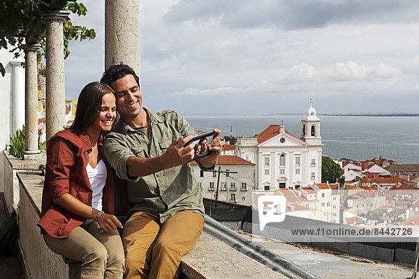 Portugal  Lisboa  Alfama  Miradouro de Santa Luzia  young couple photographing themself