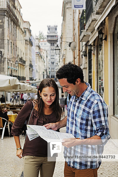 Portugal  Lisboa  Baixa  Rua Santa Justa  Elevador Santa Justa  young couple with city map