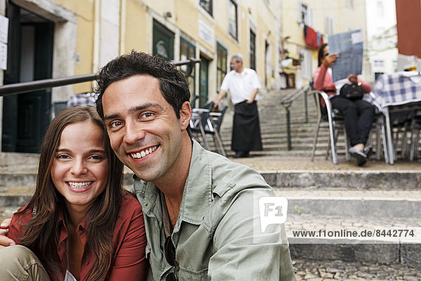 Portugal  Lisboa  Carmo  Calcada du Duque  portrait of young couple sitting at stairs