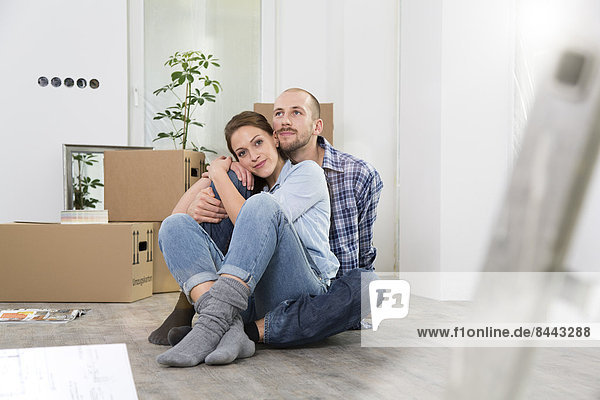 Young couple enjoying new home