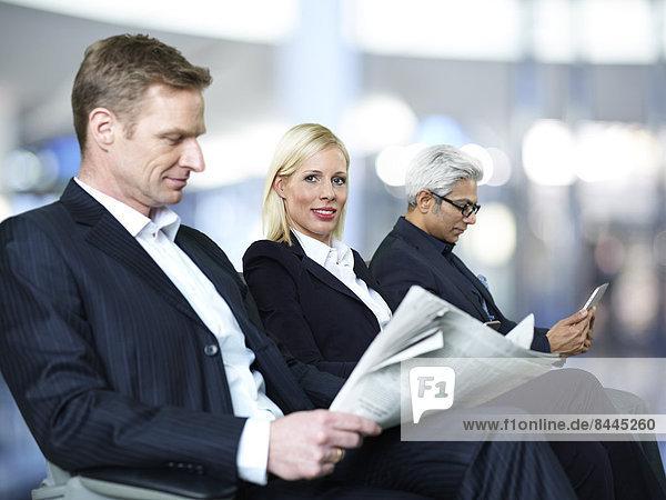 Three businesspeople waiting