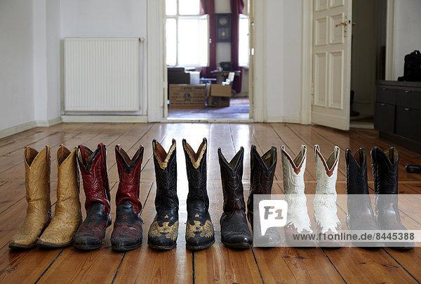 Cowboy boots on wooden floor , Cowboy boots on wooden floor