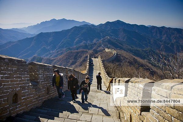 Tourists walk the ancient Great Wall of China at Mutianyu  north of Beijing (formerly Peking)  China