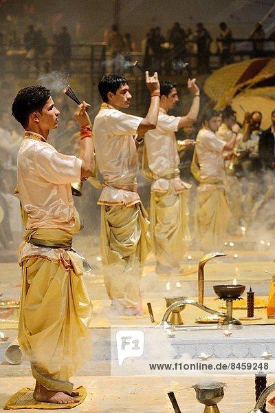 India  Uttar Pradesh  Varanasi  Offering of incense to the Ganges.