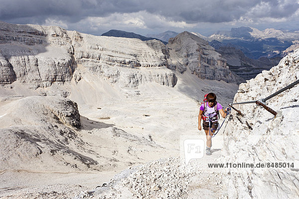 Mountain climber ascending Cunturines-Spitze Mountain in Fanes-Senes-Prague Nature Park  Val Badia  Dolomites  Alto Adige  Italy