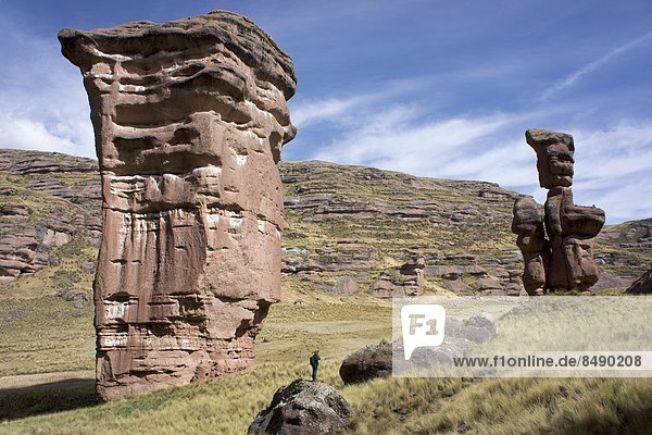 Rock formations in the Tinajani Canyon in the Andes  photographer in foreground  Peru  South America