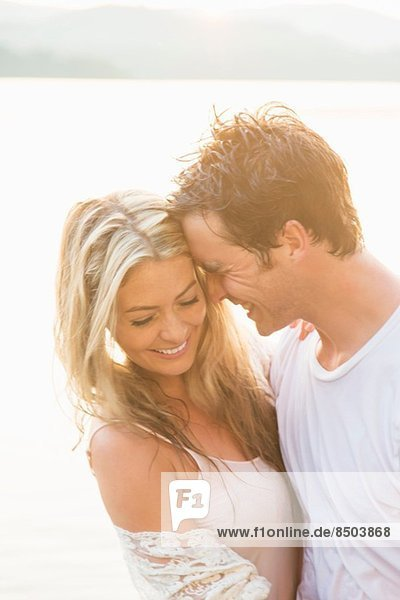 Young couple hugging  laughing