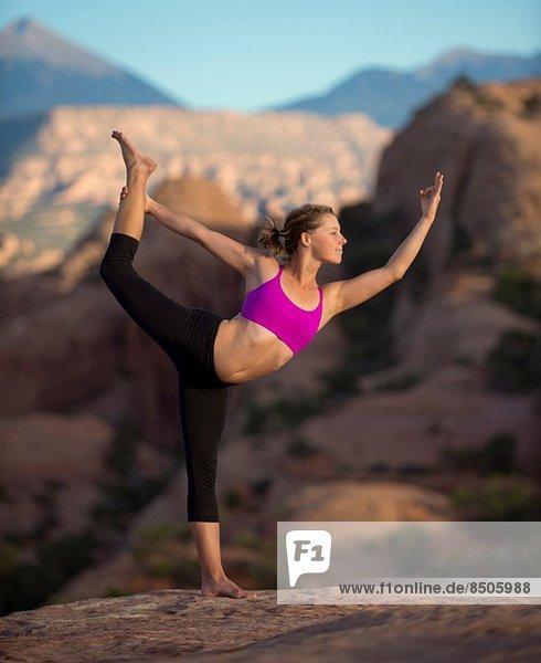 Young woman doing yoga  Moab  Utah  USA