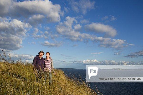 Fröhlichkeit  lächeln  Küste  Insel  Ansicht  Tochter  Mutter - Mensch