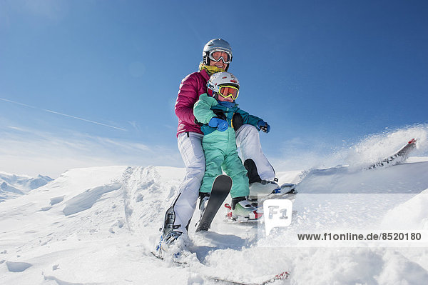 Austria  Salzburg Country  Altenmarkt-Zauchensee  Family skiing in mountains
