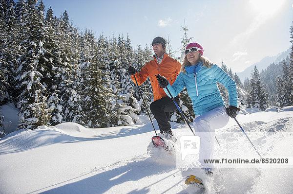 Austria  Salzburg State  Altenmarkt-Zauchensee  Couple snowshoeing in winter landscape