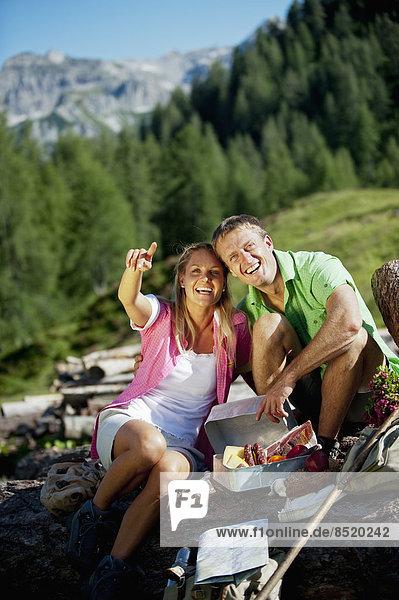 Austria  Salzburg State  Altenmarkt-Zauchensee  couple haßing a picnic on alpine meadow