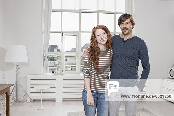 Germany  Munich  Couple at home  arms around