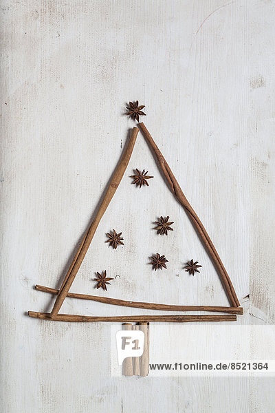 Christmas tree shaped by cinnamon sticks and star anise