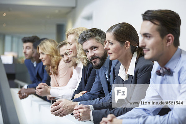 Germany  Neuss  Group of business people  leaning on railing