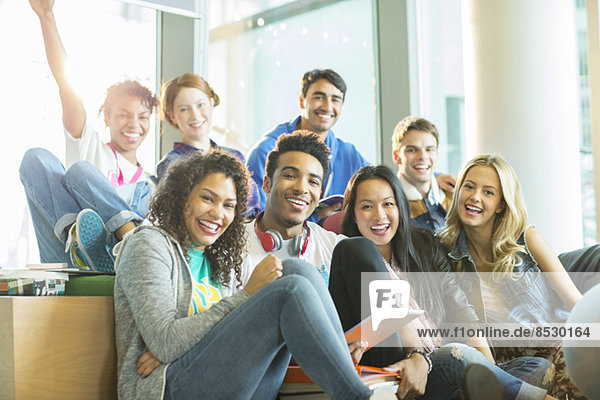 University students laughing together in classroom