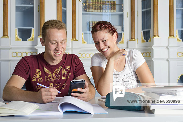 Students studying in the departmental library of the University of Hohenheim in Schloss Hohenheim Palace  Stuttgart  Baden-Württemberg  Germany