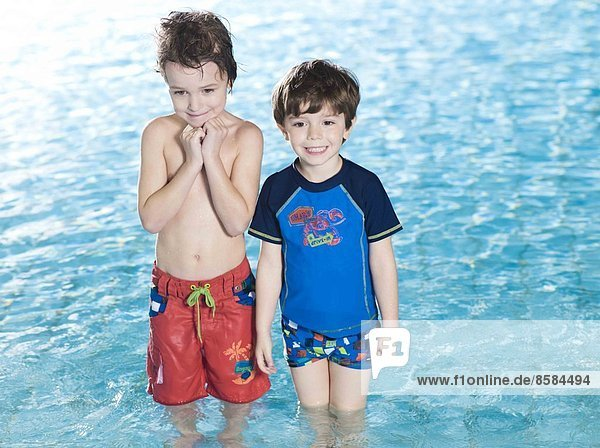 Two boys posing at the swimming pool
