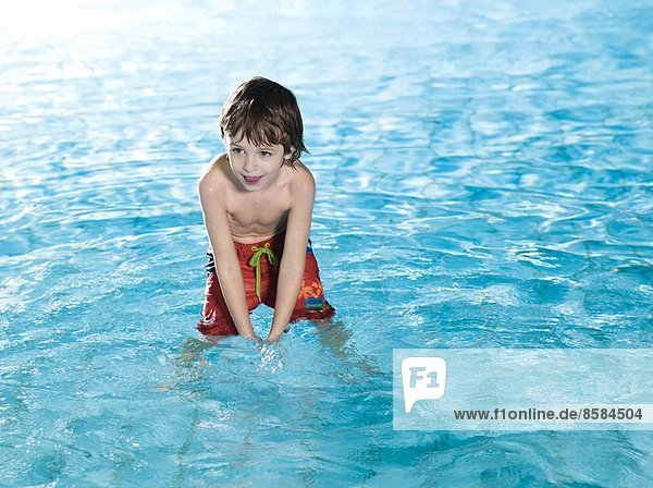 Boy smiling at the swimming pool