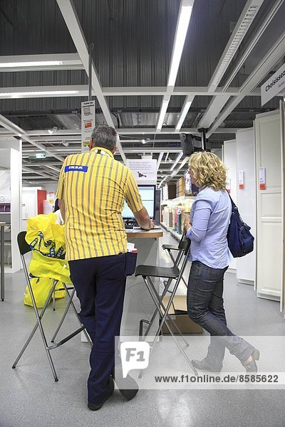 France  customer and adviser in an Ikea store.