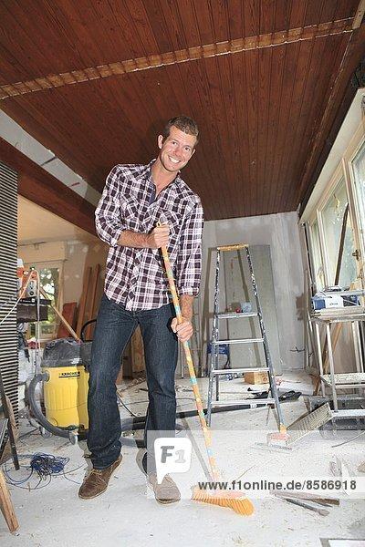 France  man renovating house.