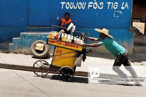 A Haitian man sells home made refreshing drinks on the street market in Port-au-Prince  Haiti  13 July 2008.