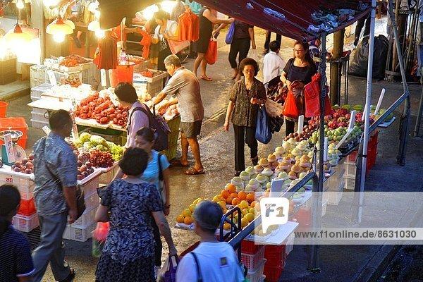 Messestand  zeigen  Frau  Mann  Nacht  Frucht  Produktion  kaufen  verkaufen  Insel  Verkäufer  China  Hongkong  Marktplatz