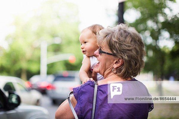 Grandmother holding granddaughter