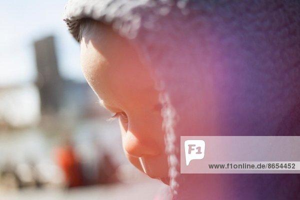 Toddler girl wearing hood
