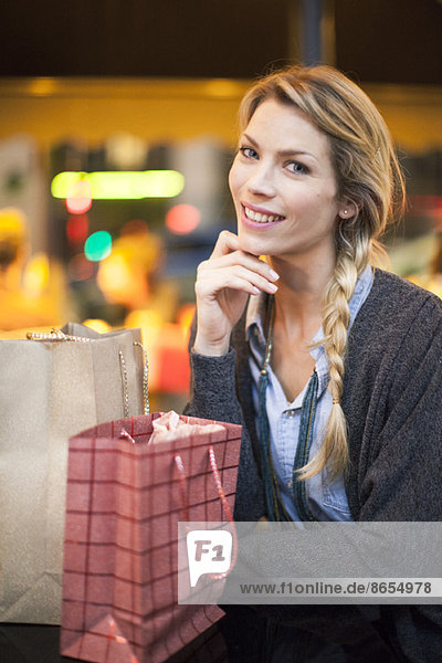 Satisfied shopper with her purchases  portrait