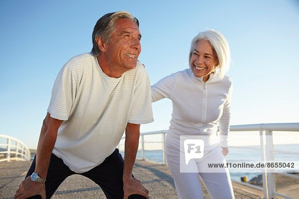 Couple doing squatting exercise