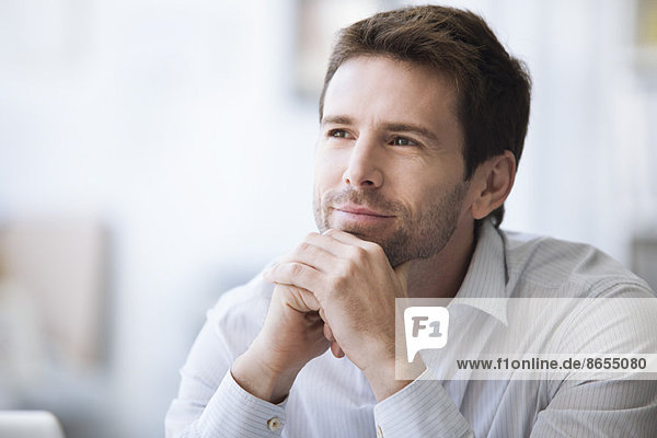 Mid-adult man in thought  portrait