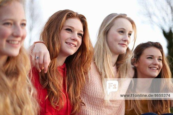 Four teenage girlfriends posing for portrait