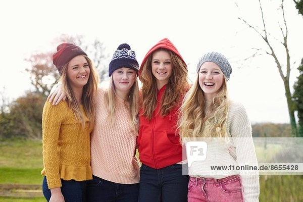 Portrait of four teenage girls in knitted hats