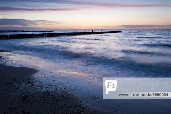 Groyne at sunset on the coast at  Nienhagen  Mecklenburg-Western Pomerania  Germany