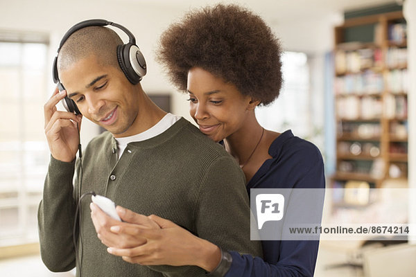 Couple using mp3 player together