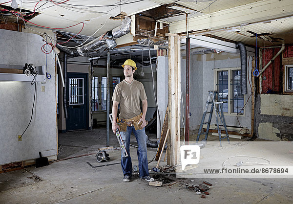 Caucasian construction worker in hard hat on site