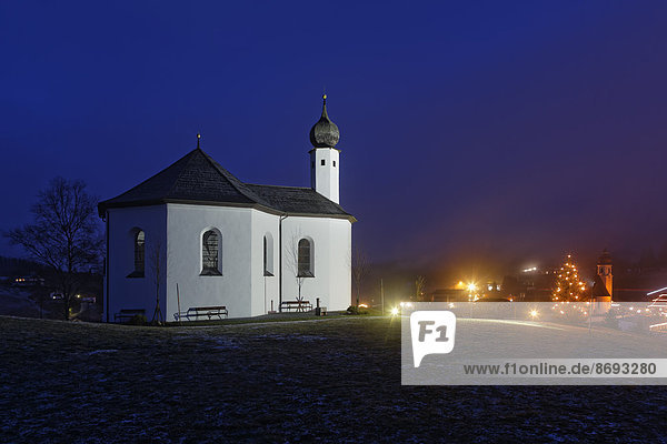 Austria  Tyrol  Achenkirch  view to Church of St. Ann and lighted christmas tree by night