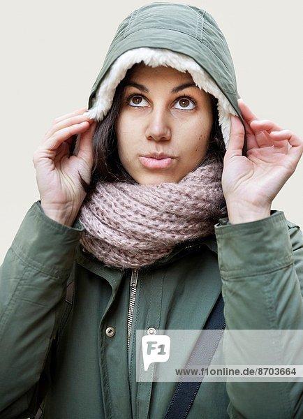 Young girl with hood.
