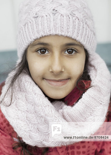 Portrait of girl in warm clothing outdoors