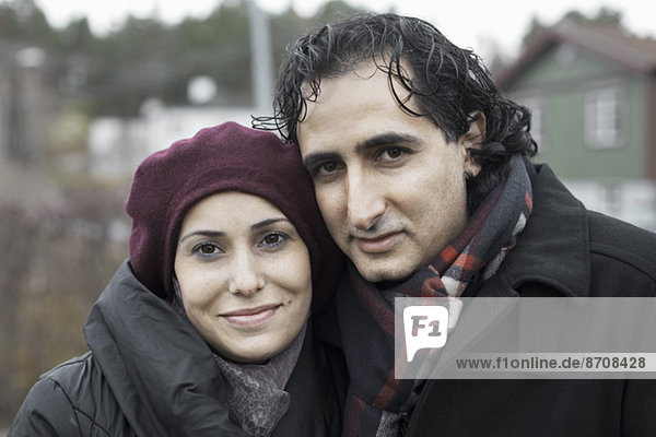 Portrait of smiling couple outdoors in winter