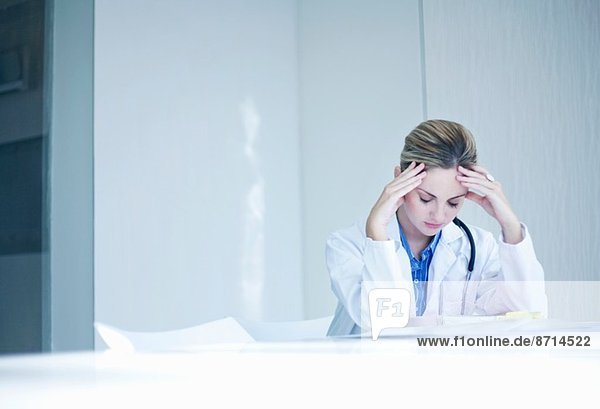 Stressed young female doctor
