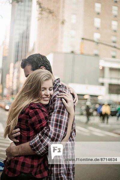 Young couple hugging on street  New York City  USA