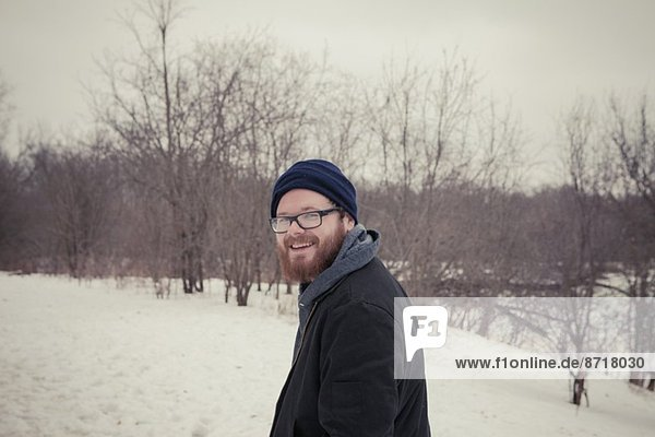 Portrait of young man out walking in snow