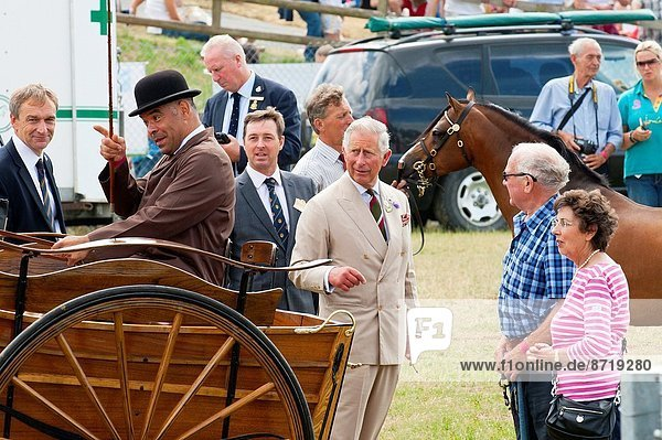 Llanelwedd  Powys  UK. 24th July 2013. The Prince meets Carriage Drivers. The Prince of Wales  a former president of the Royal Welsh Agricultural Society (RWAS)  and the Duchess of Cornwall attend the Royal Welsh Show in Mid Wales. It's Prince Charles's seventh visit to Llanelwedd  where the largest agricultural show in Europe is held  but for the duchess it's her first.