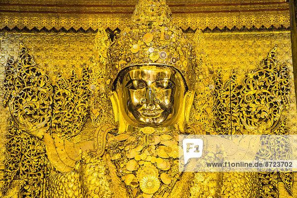 Golden seated Buddha  Mahamuni  Mandalay  Mandalay Division  Myanmar or Burma