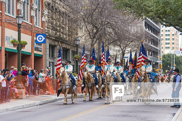 USA,  Texas,  San Antonio,  Grand opening parade of the 2014 Rodeo,  Riders with American flags on horseback